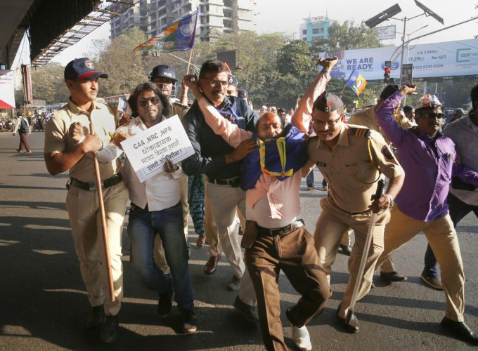 Vanchit Bahujan Aghadi (VBA) workers stage a protest during a statewide bandh against the Citizenship Amendment Act (CAA) and National Register of Citizens (NRC), in Thane, Friday, Jan. 24, 2020. (PTI Photo)