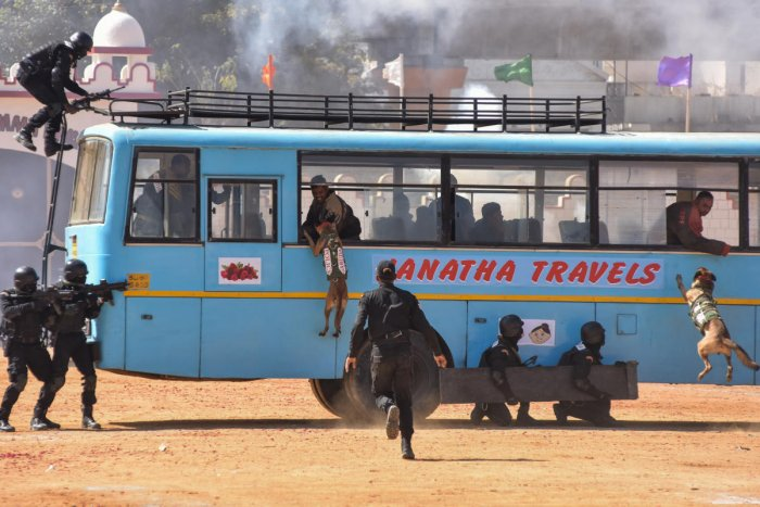 The Garud Commando Force of the Indian Air Force regaled the crowd by subjugating mock terrorists who hijacked a bus. DH photo/S K Dinesh
