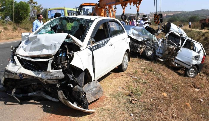 Mangled remains of two cars which hit head-on on Hubballi-Dharwad bypass near Yarikoppa Cross in Dharwad taluk on Sunday, killed four persons on the spot. DH Photo