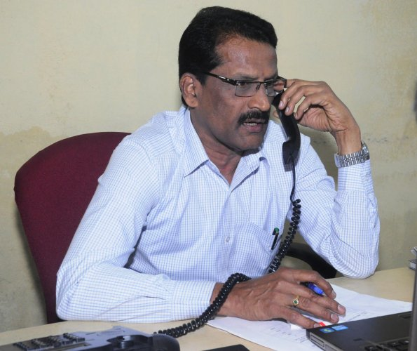 Department of Food, Civil Supplies and Consumer Affairs Deputy Director B K Kusumadhar speaks during the phone-in programme organised by Prajavani at its office in Udupi.