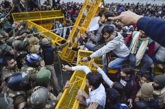 Students try to breach the police barricading during their protest march against the Citizenship Amendment Act and National Register of Citizens (NRC), near Jamia Millia Islamia university in New Delhi, Thursday, Jan. 30, 2020. (PTI Photo)