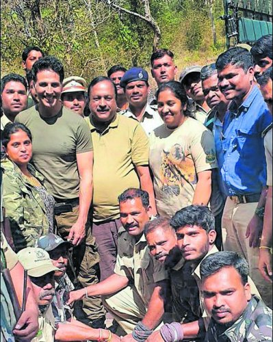 Bollywood actor Akshay Kumar seen with Project Tiger director T Balachandra and Forest department employees during his visit to Bandipur on Thursday.