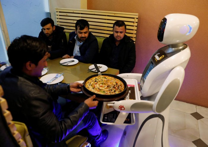 A waitress robot (Timea) delivers food to customers at the Times Fast Food restaurant in Kabul, Afghanistan February 11, 2020. (Reuters photo)