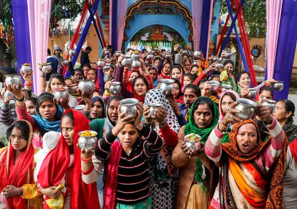 Devotees wait to offer prayers to Lord Shiva on the occasion of Maha Shivratri festival, at Aap Shambhu Temple in Jammu, Friday, Feb. 21, 2020. (PTI Photo)