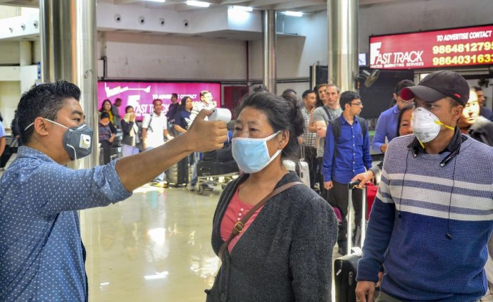 Passengers undergo a thermal screening test in the wake of novel coronavirus scare at Dimapur airport in Nagaland. (Representative image/PTI Photo)