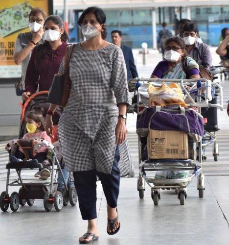 Passengers using masks due to the scare of coronavirus at the Kempegowda International Airport in Bengaluru. (DH Photo)