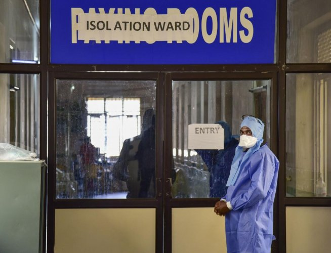 A medics stands outside an isolation ward, set up in view of coronavirus pandemic, at Gandhi Hospital in Hyderabad, Saturday, March 14, 2020. (PTI Photo)