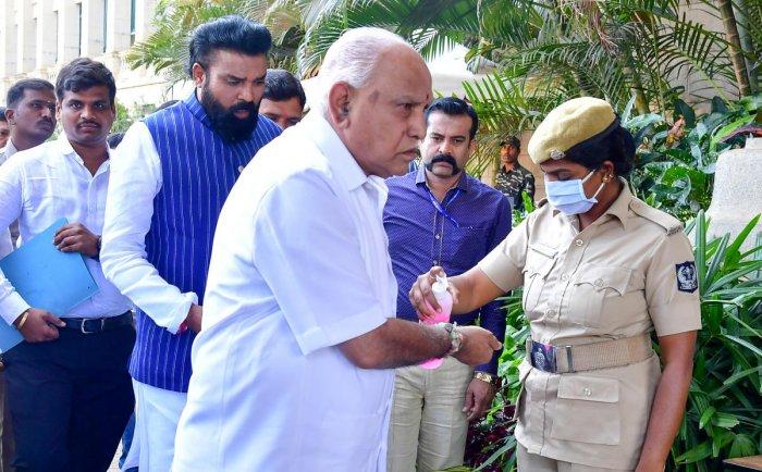 CM Yediyurappa uses a hand sanitizer before entering Vidhana Soudha on Thursday. DH Photo.