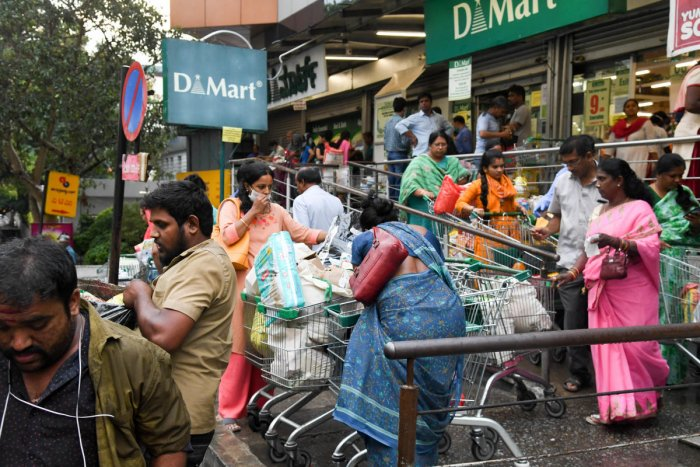 People scrambling to buy groceries was a common sight at many supermarkets on Friday. DH Photo/ B H Shivakumar