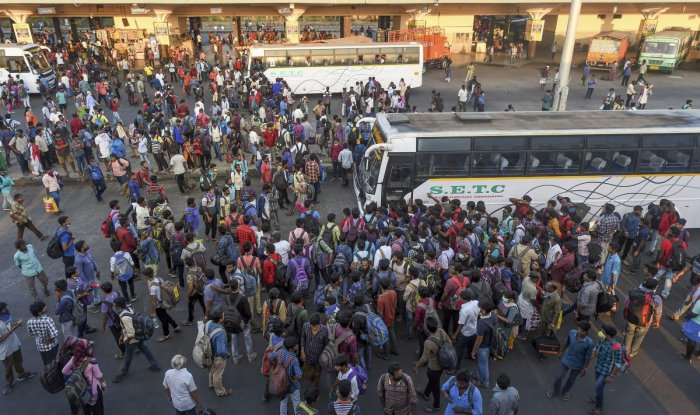 assengers rush to board State Express Transport Corporation of Tamilnadu (SETC) buses after lockdown announcement in view of coronavirus pandemic, at Koyambedu bus terminal, in Chennai. Tamil Nadu will be under a lockdown till March 31 from 6 PM on Tuesday to prevent the spread of coronavirus and CrPC section 144 will be invoked for its implementation. (PTI Photo)
