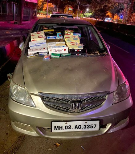 The cigarettes were delivered by this car. SPECIAL ARRANGEMENT