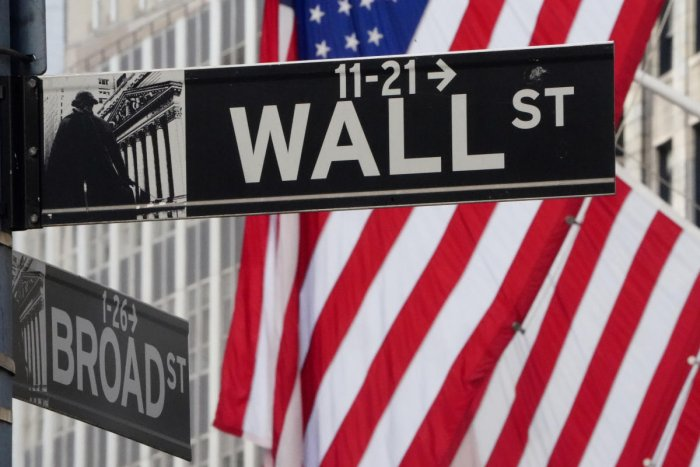 The Wall Street sign is pictured at the New York Stock exchange (NYSE) in the Manhattan borough of New York City.