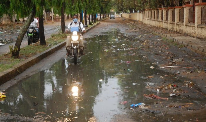 A two-wheeler rider finds it difficult to ride on KEB double road in Kolar on Saturday.
