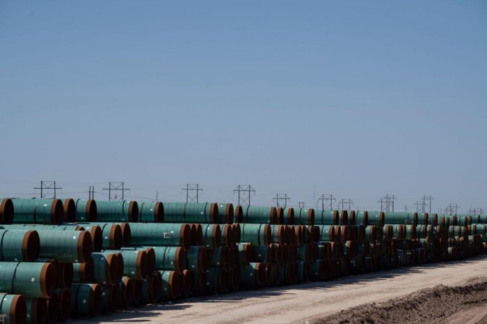 Oil pipes remain in storage on April 24, 2020 near Odessa, Texas. - Oil and gas is one of the main economic drivers of this area, and the industry has taken a hit after the price of oil dropped below zero earlier this week due to decline in demand from th