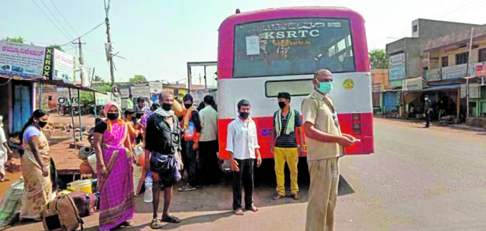 Labourers from Bagalkot, who had migrated to Dakshina Kannada district in search of work, return to their town in Kulageri Cross of Badami taluk by the special KSRTC bus arranged for them.