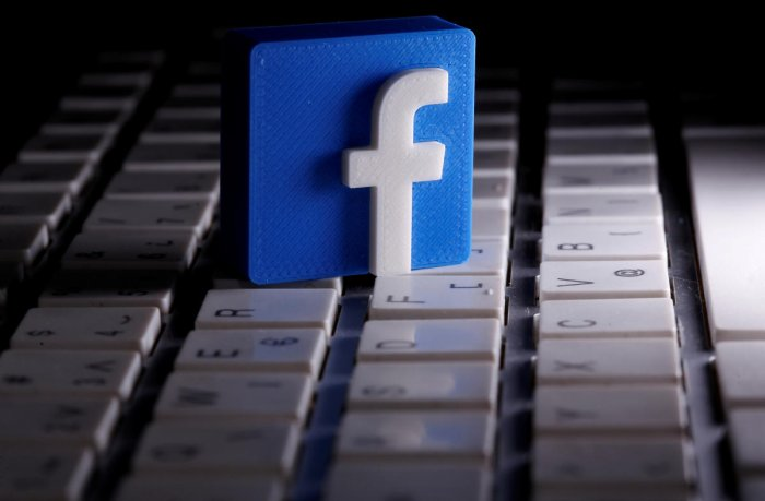 FILE PHOTO: A 3D-printed Facebook logo is seen placed on a keyboard in this illustration taken March 25, 2020. REUTERS/Dado Ruvic/Illustration/File Photo GLOBAL BUSINESS WEEK AHEAD