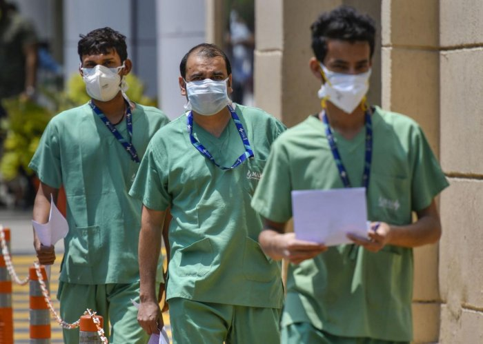 Health workers seen inside the premises of Max Hospital, during the nationwide lockdown to curb the spread of coronavirus, in New Delhi. PTI