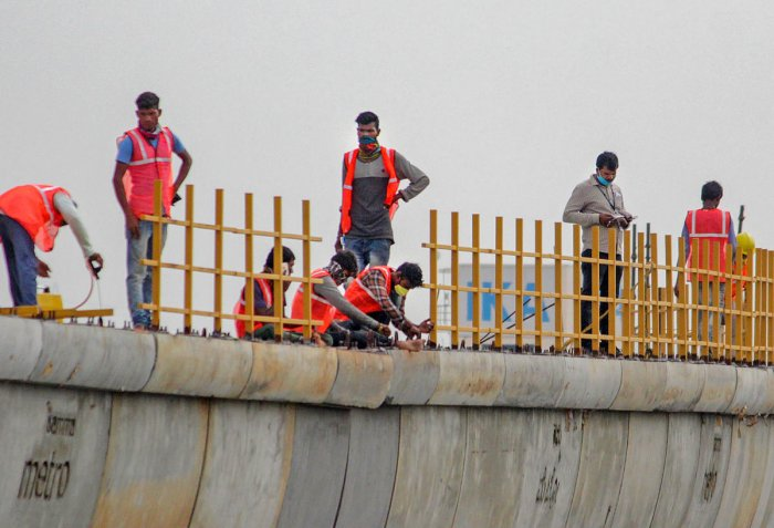 Workers resume construction of Namma Metro during the lockdown in Bengaluru, Monday, April 27, 2020. PTI