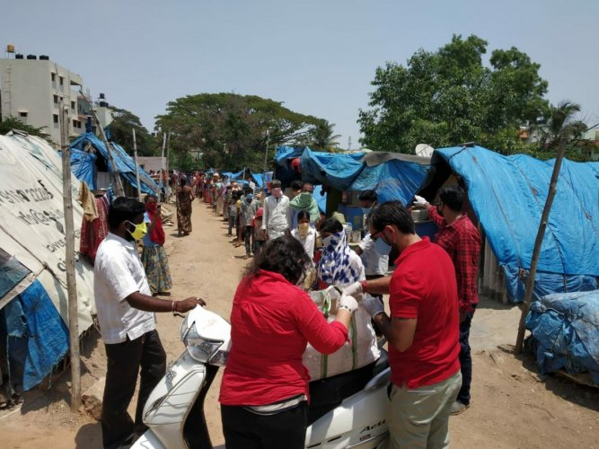 Corona Warriors distribute essential commodities to the needy.