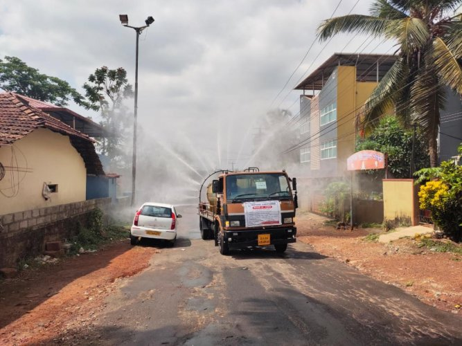 Disinfectant sprayed at Shakthinagara on Tuesday after a mother and son tested positive for Covid-19.
