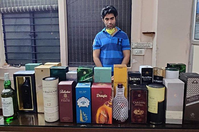 Roshan Bhateja with his duty-free liquor stock. Special arrangement