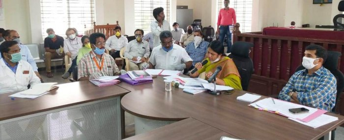 Deputy Commissioner C Satyabhama chairs a meeting with members and representatives of unions of industries in Kolar on Wednesday.