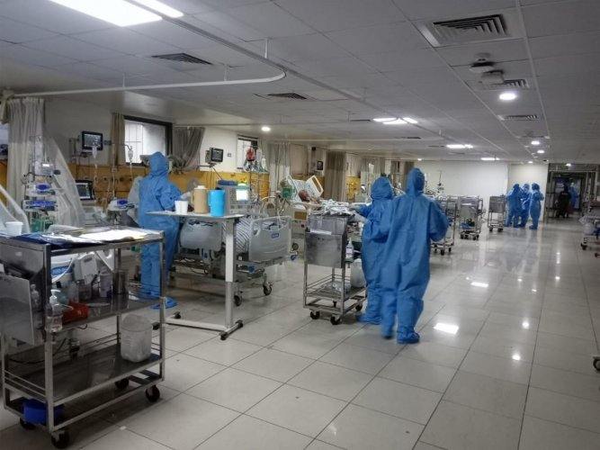 Doctors go about wearing personal protective equipment (PPE) at the 15-bed Covid ICU at St John's Medical College Hospital, Koramangala.