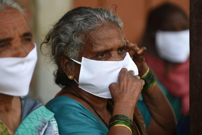 Leprosy affected people, wear facemasks being distributed by a non-governmental organisation amid concerns over the spread of the COVID-19 novel coronavirus, at Gandhi Leprosy Seva Sangh, a rehabilitation centre for leprosy patients, in Ahmedabad. (AFP Photo)