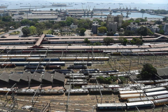 An aerial view shows parked trains at Chhatrapati Shivaji Maharaj railway terminus during a one-day Janata curfew imposed as a preventive measure against COVID-19. AFP