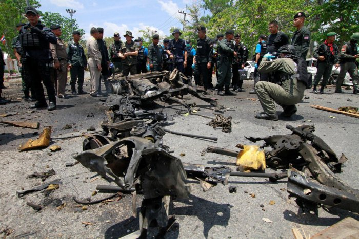 Security personnel inspect the site of a car bomb after if exploded in front of the government's Southern Border Provinces Administrative Centre in Yala. Credit: Reuters Photo