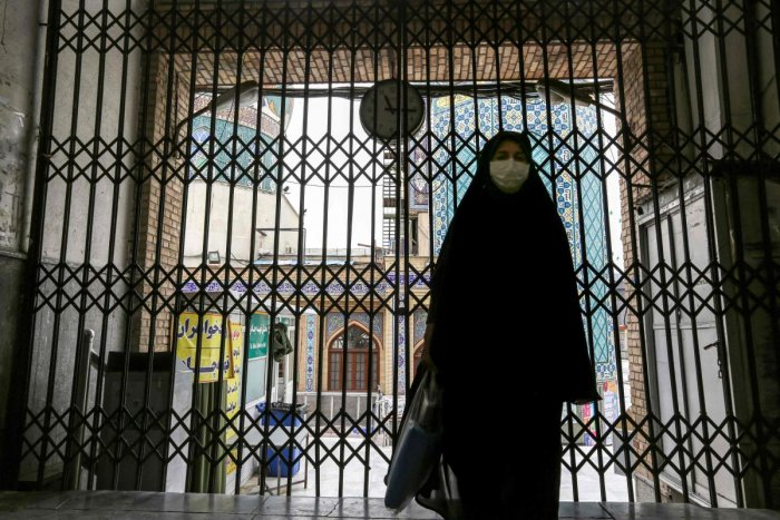 A woman walks past the closed gate outside the Imamzadeh Saleh in the Iranian capital Tehran's Shemiran district on April 25, 2020 during the Muslim holy month of Ramadan, as all mosques and places of worship are closed due to the COVID-19 coronavirus pandemic. Credit: AFP Photo
