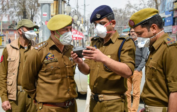Police uses drone to keep a check in the interior areas, during restrictions imposed as a precautionary measure to contain the spread of coronavirus, in Srinagar, Monday, March 23, 2020. Credit: PTI Photo