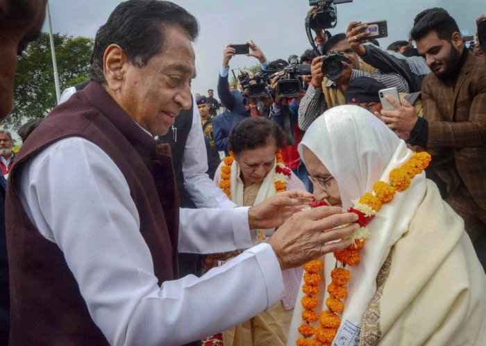 Madhya Pradesh Chief Minister Kamal Nath felicitate family members and widows of army personnel at a programme organised on the occasion of Vijay Diwas. PTI