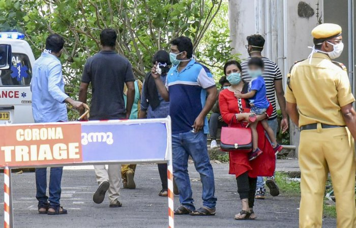 Visitors wear protective masks outside the Special Isolation Ward set up to provide treatment to novel coronavirus patients at Kochi Medical college, in Kochi, Monday, March 9, 2020. (PTI Photo)