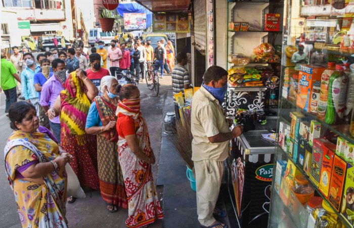 People stand in a queue outside a chemist shop while maintaining social distance, during the nationwide lockdown in the wake of coronavirus pandemic, at Khetwadi, in Mumbai, Wednesday, March 25, 2020. (PTI Photo)
