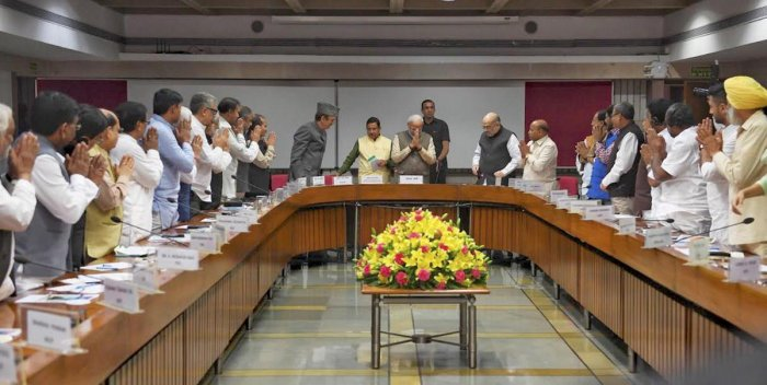 rime Minister Narendra Modi being greeted by various party leaders on his arrival for an all-party meeting ahead of the winter session of Parliament. PTI
