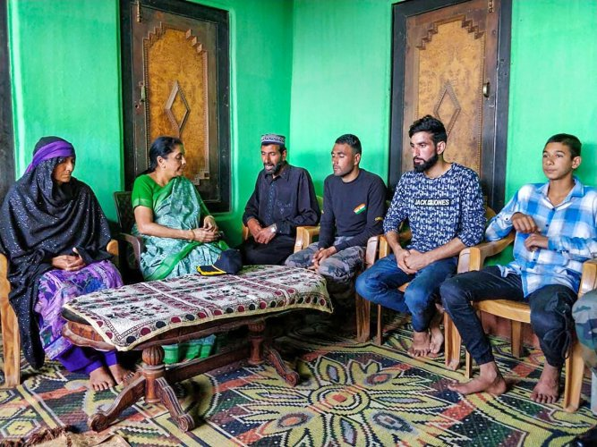 Defence Minister Nirmala Sitharaman pay condolences to rifleman Aurangzeb's family, in Poonch on Wednesday, June 20, 2018. Aurangzeb was abducted from Pulwama by terrorists and later his bullet-ridden body was recovered on June 14. (@DefenceMinIndia Twitter Photo via PTI)