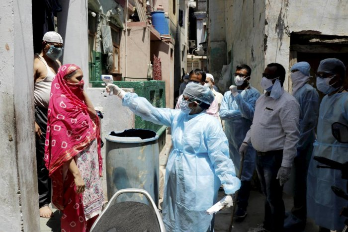 A medical team conducts door-to-door survey to screen people for COVID 19 symptoms, during the nationwide lockdown imposed in wake of the coronavirus outbreak, in Ahmedabad, Thursday, April 23,2020. (PTI Photo)