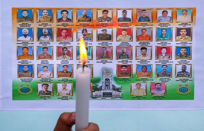 Students pay tribute to the martyred CPPF jawans, who lost their lives in a suicide bomber attack in Pulwama last year, in Jammu, Friday, Feb. 14, 2020. (PTI Photo)