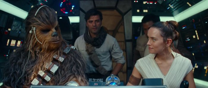 Chewie, Rey, Poe, Finn and Threepio (not seen) on the Millennium Falcon in The Rise of Skywalker.