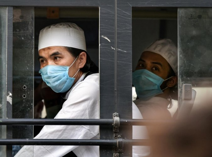 Members of the Tablighi Jamaat leave in a bus from LNJP hospital for the quarantine centre during the nationwide lockdown, in wake of the coronavirus pandemic, in New Delhi, Tuesday, April 21, 2020. (PTI Photo)