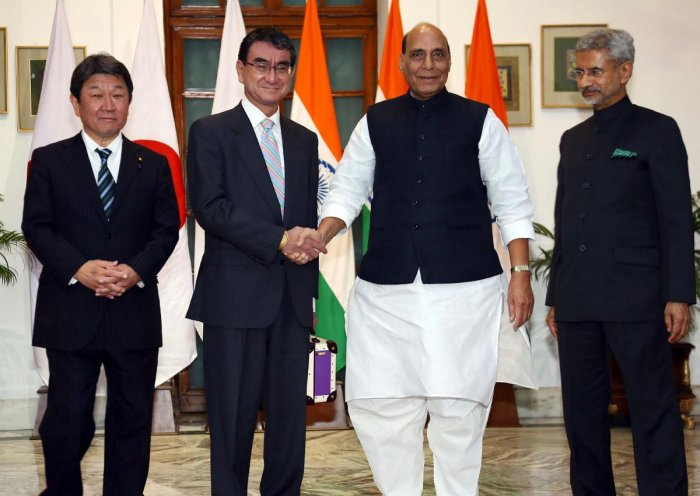 In this handout photograph taken and released by Indian Press Information Bureau on November 30, 2019, Japan's Defence Minister Taro Kono (2L) shakes hands with his Indian counterpart Rajnath Singh (2R) as India's Foreign Minister Subrahmanyam Jaishankar (R) and his Japanese counterpart Toshimitsu Motegi (L) pose during their bilateral talks in New Delhi. (Photo by Handout / PIB / AFP)