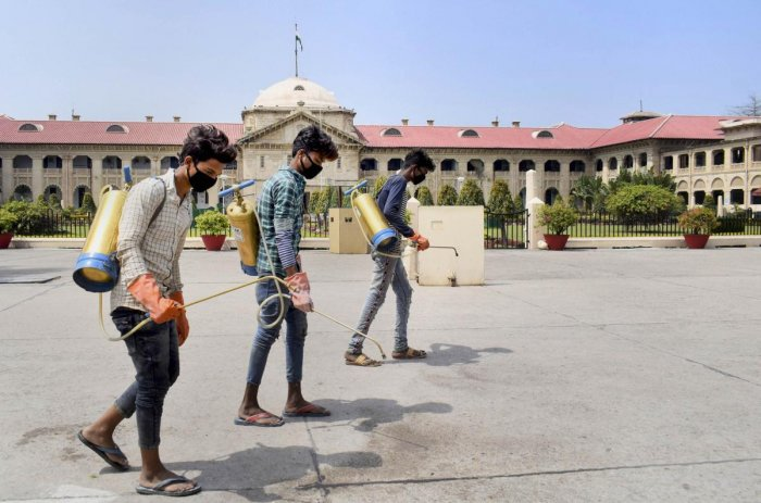 Workers fumigate the premises of the Allahabad High Court, closed as a precautionary measure against the spread of coronavirus. PTI