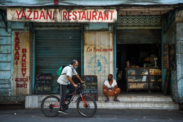 A man rides his bicycle past the Yazdani bakery, one of the city's oldest, during a government-imposed nationwide lockdown as a preventive measure against the spread of the COVID-19 coronavirus in Mumbai on April 28, 2020. Credit: AFP Photo
