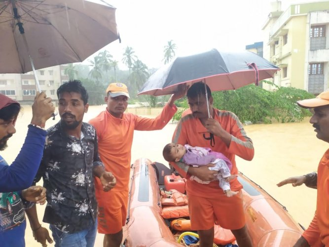 NDRF personnel rescued a baby at Charmadi village in Belthangady on Saturday.