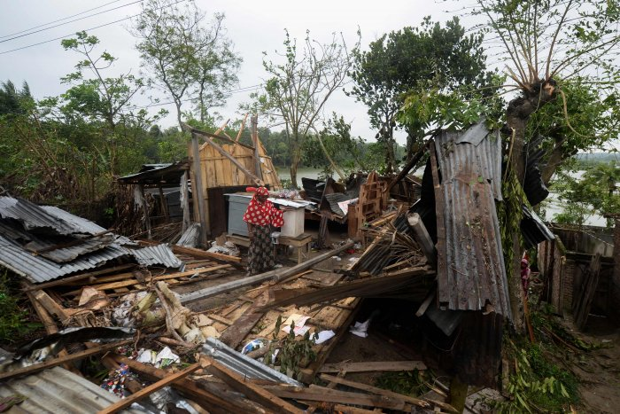 A woman stands amidst the debris of her house damaged by cyclone Amphan in Satkhira on May 21, 2020. (AFP photo)