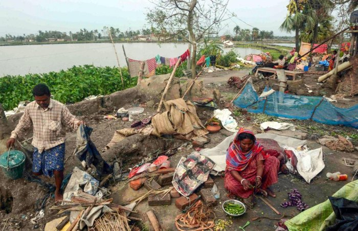 A woman cooks food in a damaged house, in the aftermath of Cyclone Amphan, in South 24 Paraganas district of West Bengal, Friday, May 22, 2020. (PTI Photo)