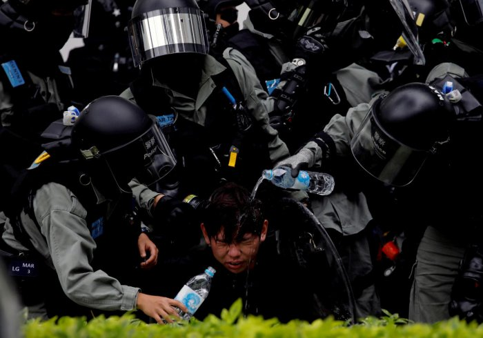 Riot police pour water on the face of anti-government protester after an anti-parallel trading protest at Sheung Shui, a border town in Hong Kong. Reuters