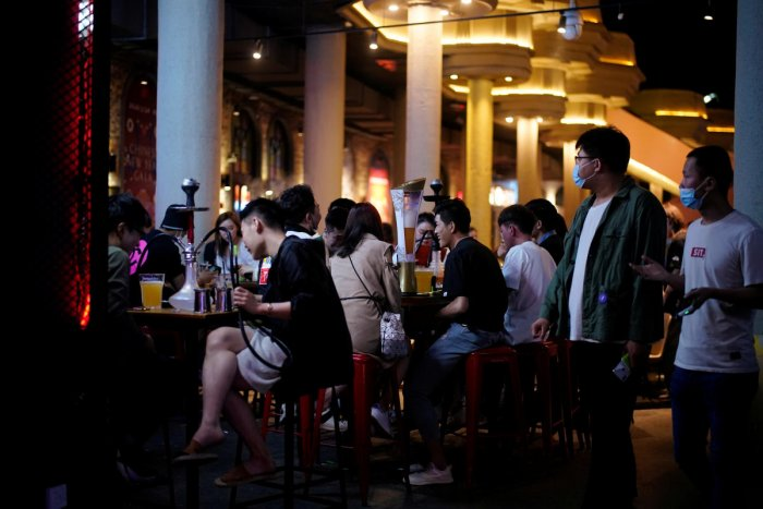 People wearing face masks are seen at a bar area in a nightclub after it reopens in Shanghai. Reuters