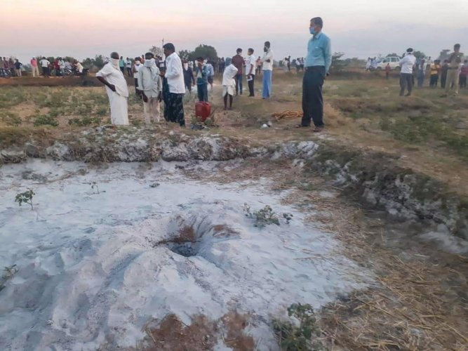 Villagers and officials at a site where a three-year-old boy slipped into a borewell while playing near it at Podechenpally village in Medak district, Wednesday evening, May 27, 2020. (PTI Photo)